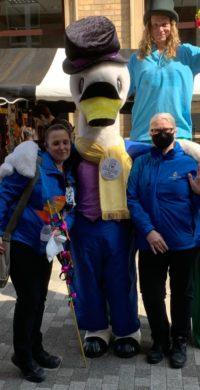 Kidderminster Bid rangers Becky and Yasmin with Sammy the Swan and the stilt walker
